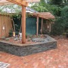 natural stone bluestone retaining wall with pergola in minneapolis